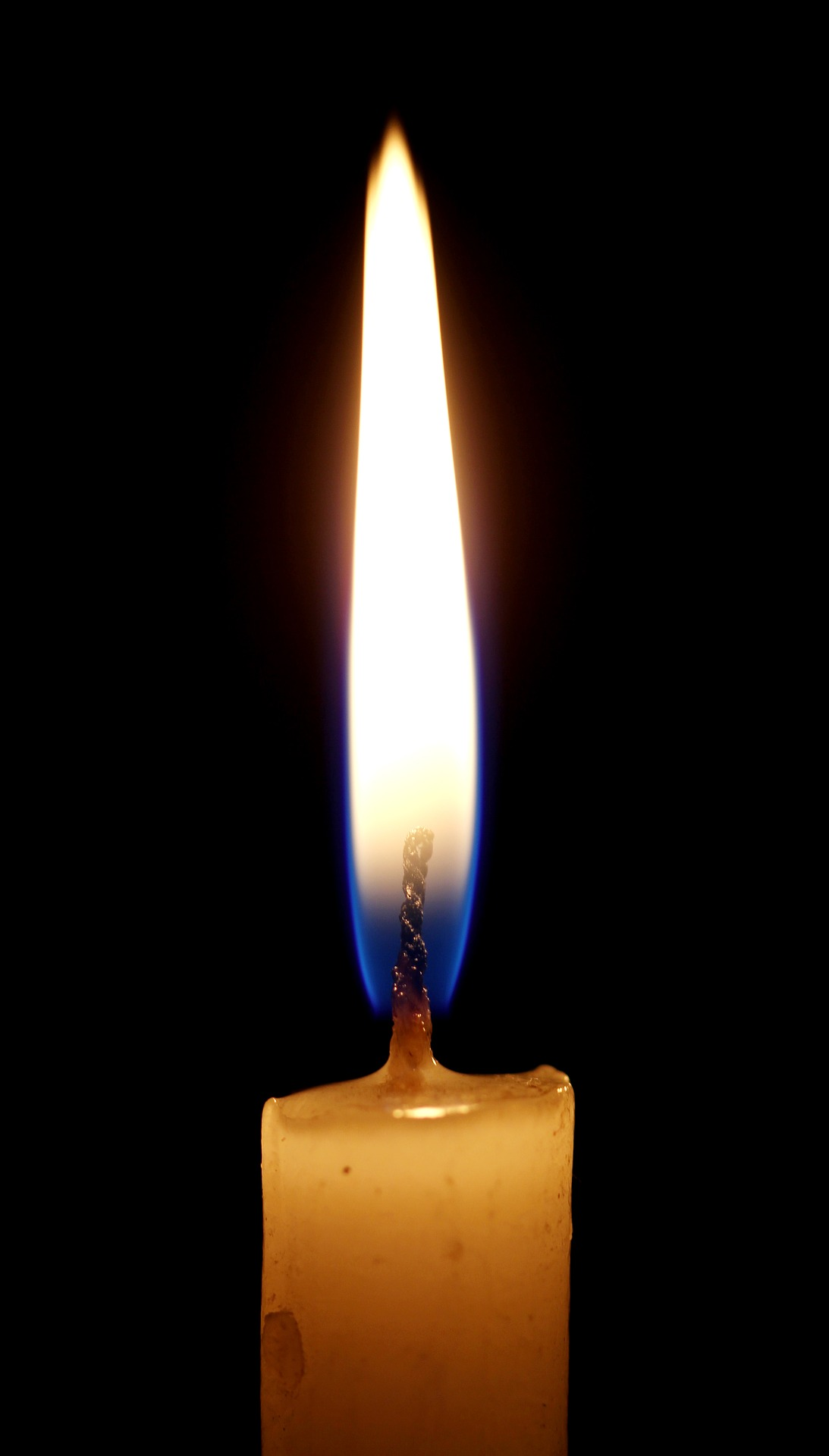 A candle lit in memory of a loved one.